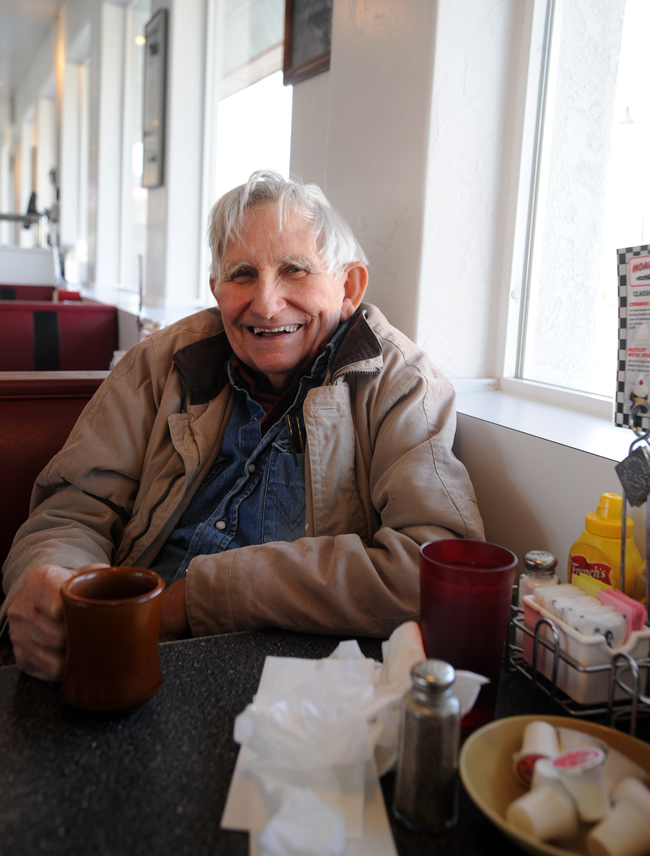 Ken Sleight, who majored in business at the University of Utah, enjoys a cup of coffee at the Moab Diner. (Photo by Stephen Speckman)