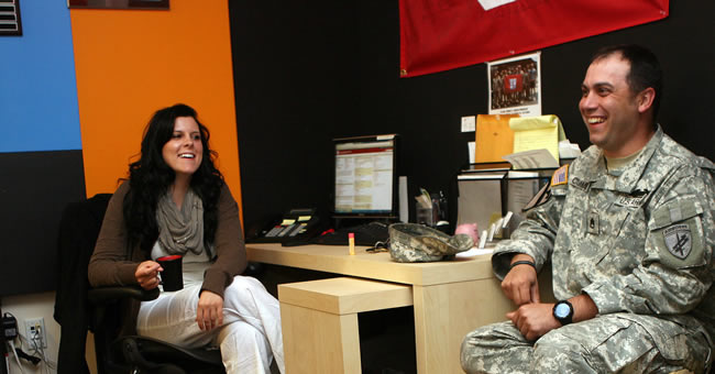 Mary Huggins and Michael Cumming chat with one another at the Veterans Support Center.