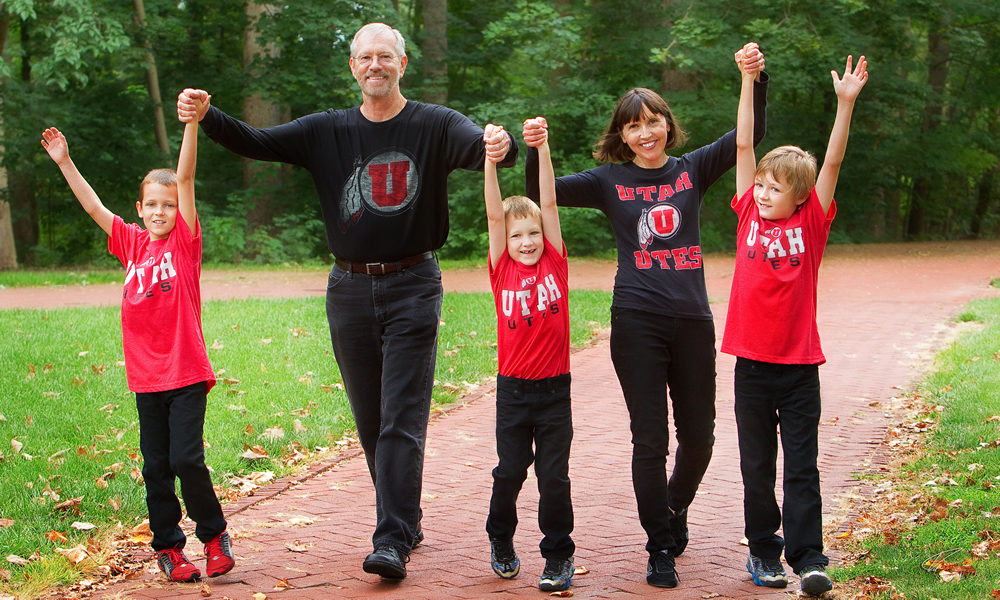 University of Utah library dean Alberta Comer and her husband, John Comer, with three of their grandchildren. (Photo by Kip May)