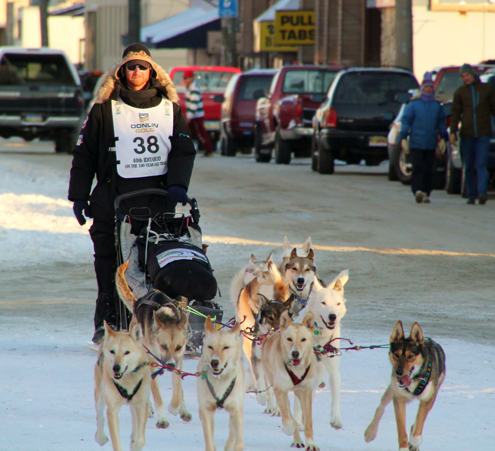 Justin Savidis guides his team of dogs as they run up Front Street to the 2012 Iditarod finish line in Nome, Alaska. (All photos courtesy Rebecca and Justin Savidis)