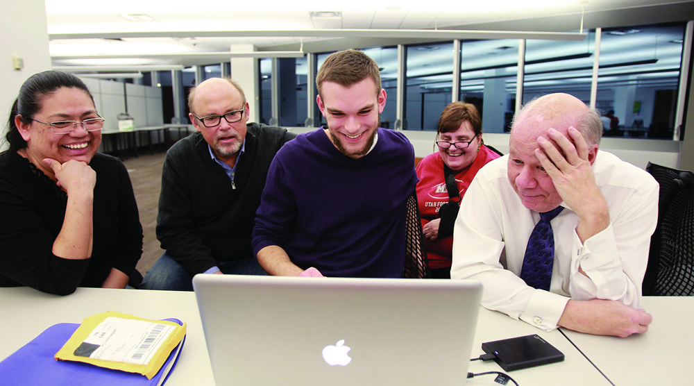 From left, Lucia Chavarria, Jeff Metcalf, Sam Katz, Judy Fuwell, and Craig Worth watch Katz's documentary video during the Humanities in Focus class at the U's Marriott Library.
