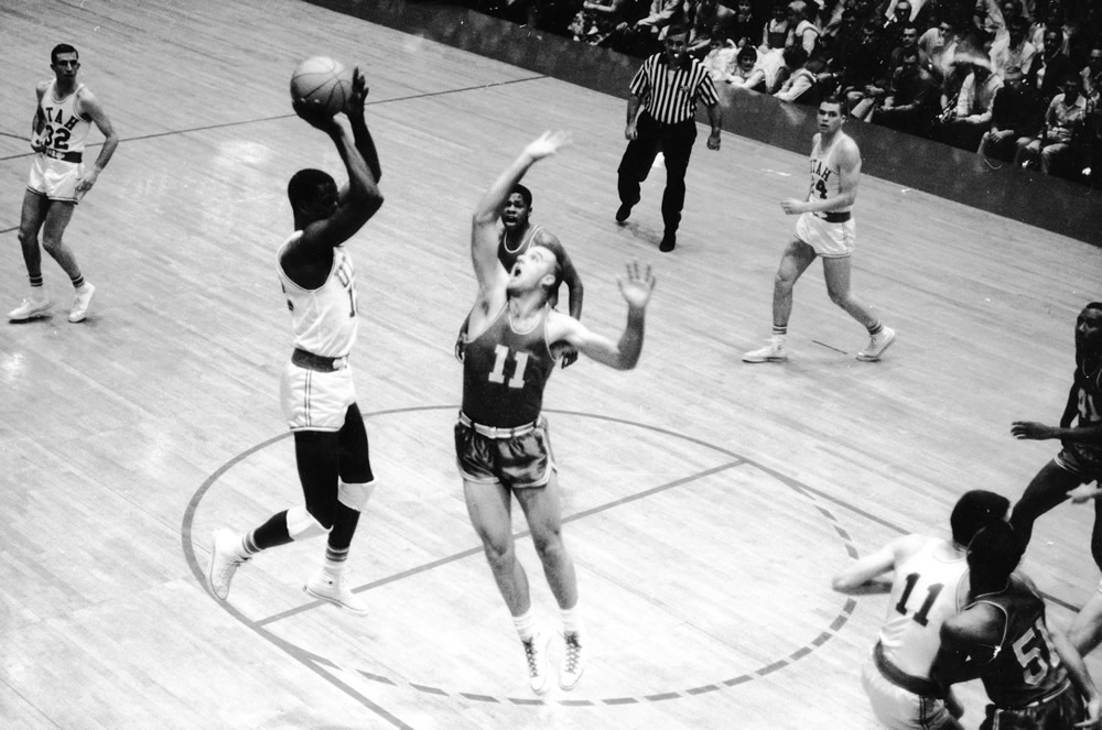 Billy McGill leaps for a basket during a U game. He was a two-time All-American and a top NBA pick. Photo courtesy Special Collections, J. Willard Marriott Library, University of Utah