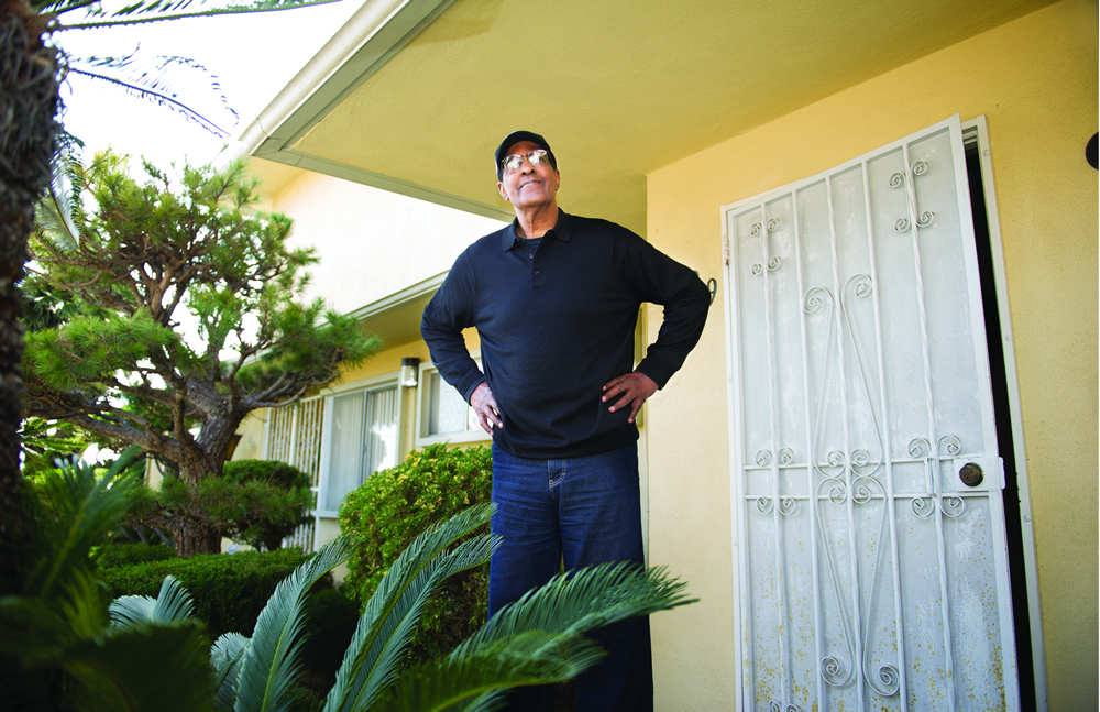 McGill stands outside his home in Los Angeles. He eventually worked for Hughes Aircraft after leaving the NBA. (Photo by Ed Carreón)