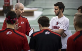 Roeland Brateanu, left, the University of Utah's head coach for men's tennis, talks with assistant coach Daniel Pollock and members of the team during a practice session in the U's Eccles Tennis Center.