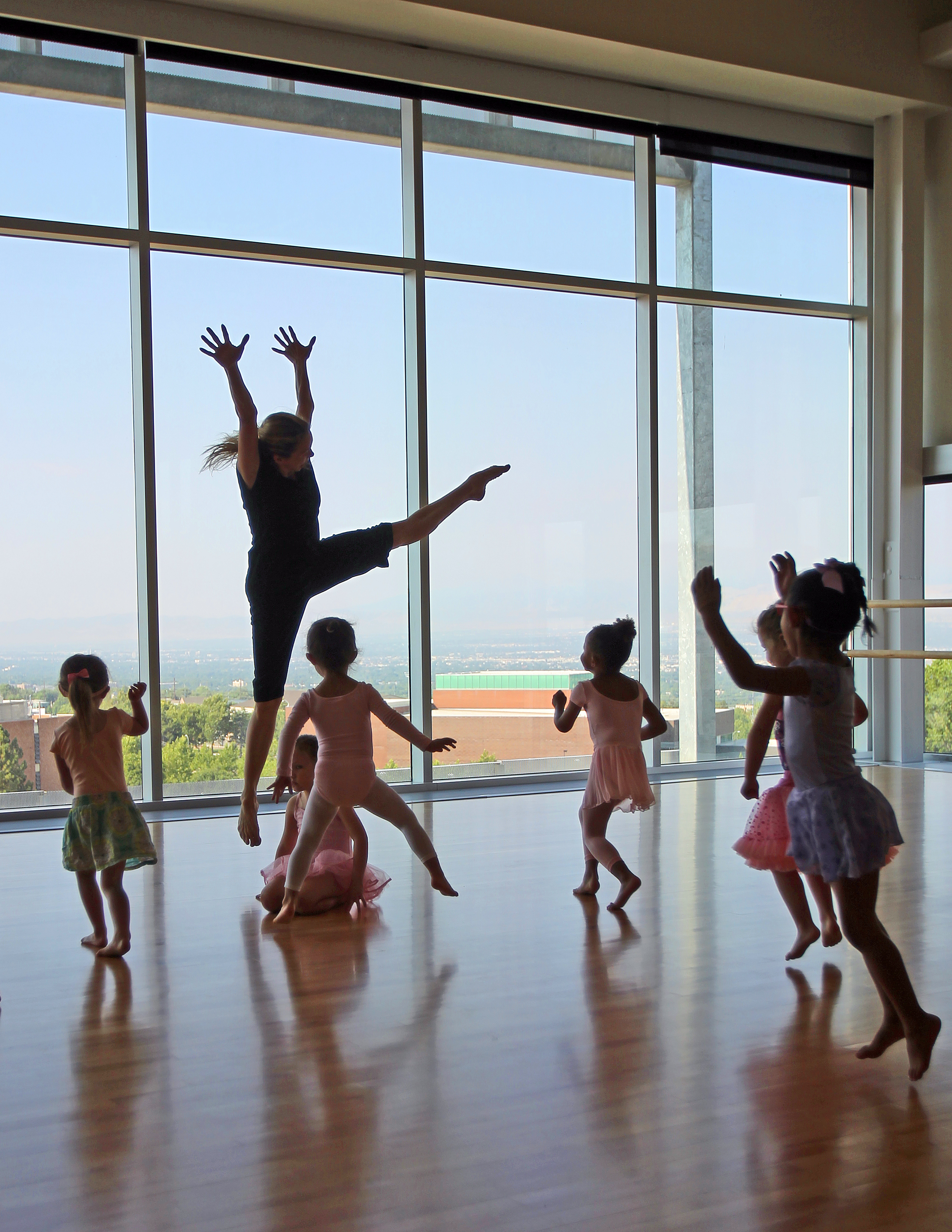 Tiny dancers imitate fireworks exploding, in a creative movement class taught by Chara Huckins at the Beverley Taylor Sorenson Arts and Education Complex. (Photo by Brian Nicholson)