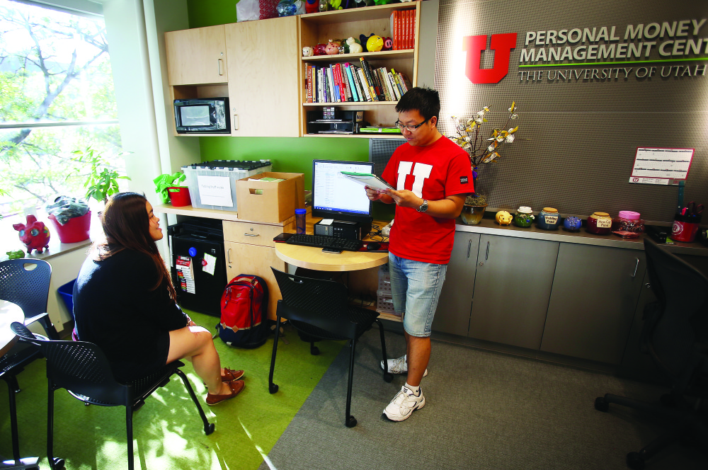 U student Olivia Wan works with Kevin Yu in the University's Personal Money Management Center.