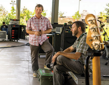 Chris Mautz and Derrek Hanson backstage prepping for Willie Nelson's performance in July.