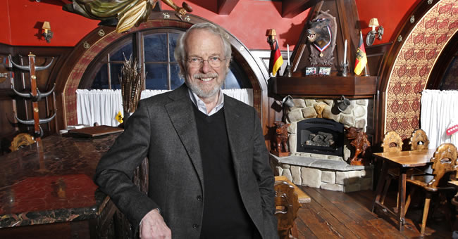 Adobe Systems co-founder John Warnock relaxes inside the whimsical interior of the Blue Boar Inn that he and his wife, Marva, own in Midway, Utah. (Photo by Tom Smart)