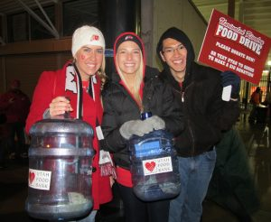 From left, U students Christine Thorup, Megan Mansell, and Kip Chaichana gather donations.