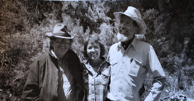 From left, Ken Sleight, tourist Carol Grohe, and author Edward Abbey pause for a photo during a 1988 horseback trip through Grand Gulch in Utah. Abbey died the following year, in 1989, in Arizona. (Photo courtesy Ken Sleight)