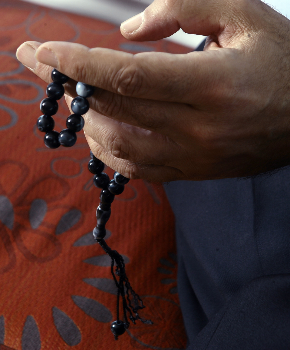 Chibli Mallat, who is pointedly nonsectarian, runs his fingers through beads to keep his hands busy. (Photo by Brian Nicholson)