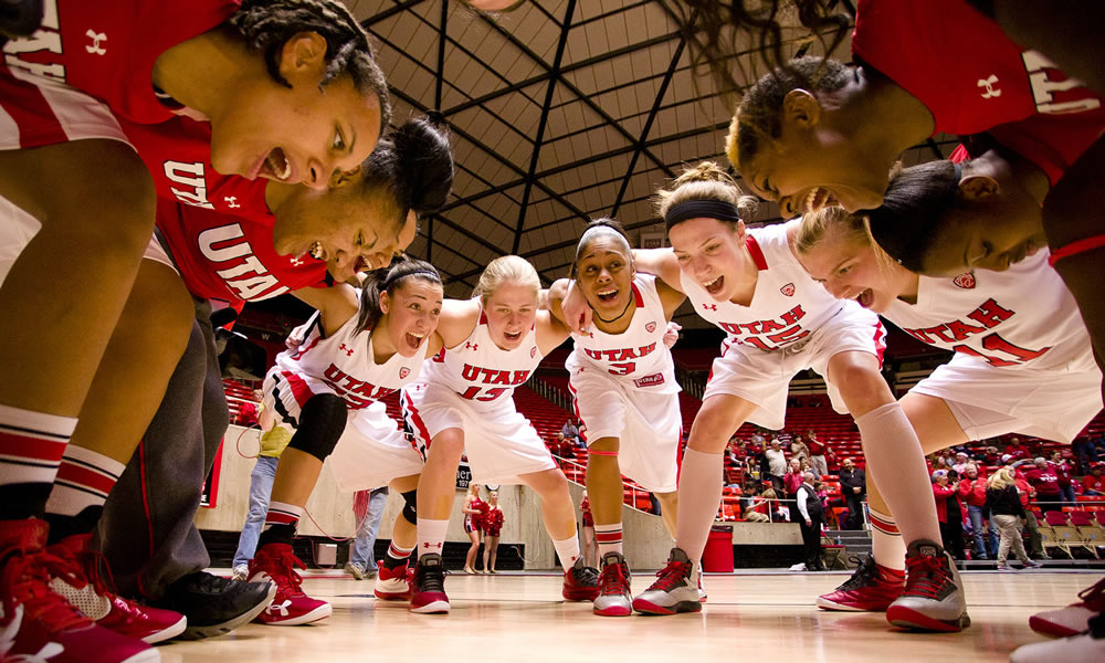 The U team huddles for a cheer during a game last March against San Diego during the WNIT. The U won , 61-50, and advanced to the championship game. (Photo courtesy University of Utah Athletics Department)