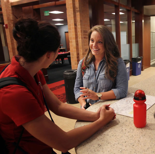 Sarah Hammer, right, talks with Emily Glende at the Heritage Center. (Photo by Brian Nicholson)