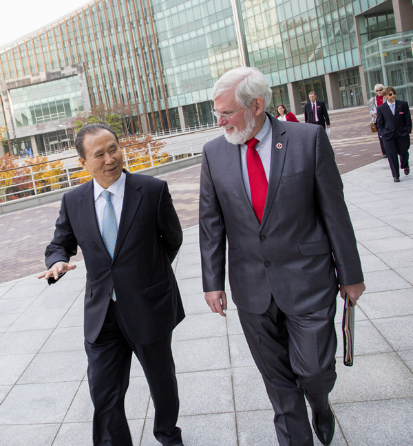 University of Utah President David W. Pershing, right, takes a tour of the Songdo Global University campus in South Korea in November with Heeyhon Song, president and CEO of the Songdo Global University Foundation.