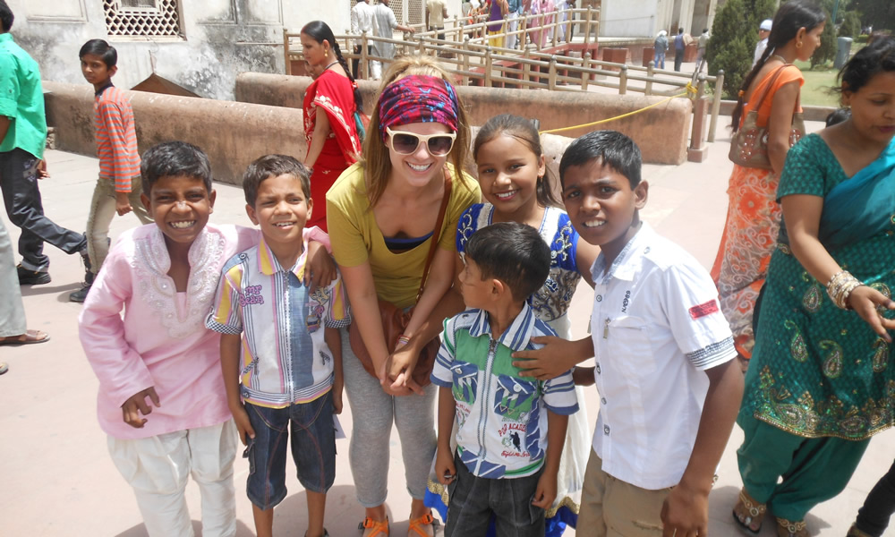 University of Utah student Lisa Hawkins, center, shown here with Indian children in New Delhi's Red Fort complex last May, was an intern with Maitri India, a nongovernmental organization that advocates for India's most vulnerable.
