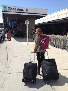 Lisa Hawkins, shown here at the Salt Lake City Airport as she prepares to depart for India, now wants a career where she can do international work. (Photo Courtesy Lisa Hawkins)