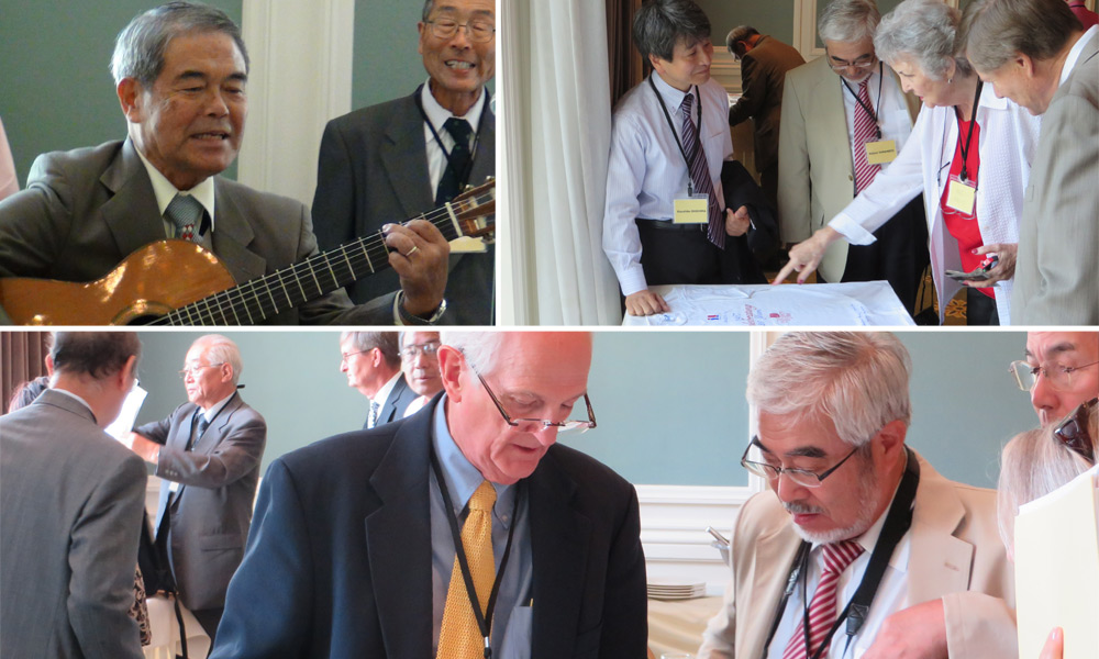 Top left: Teruo Ishii plays the guitar and leads the alumni group in song at the September luncheon. Top right: From left, Kazuhiko Ohshima, Kojuro Yamamoto, Patricia Jarvis, and Mark Johnston look at keepsakes and photos. Bottom: Michael Sanders, left, and Kojuro Yamamoto look at alumni memorabilia.