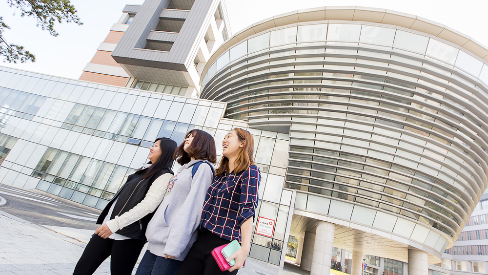 South Korean students walk past a building on the new Songdo campus. (Photo by Nick Steffens)