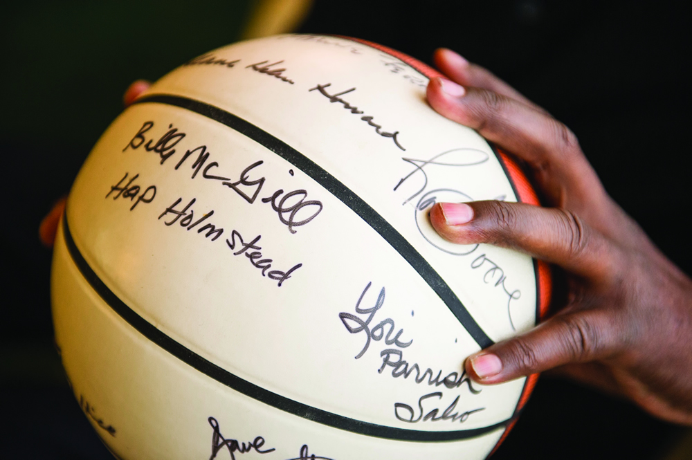 McGill holds a basketball from his University of Utah days, signed by many of his teammates at the U. (Photo by Ed Carreón)