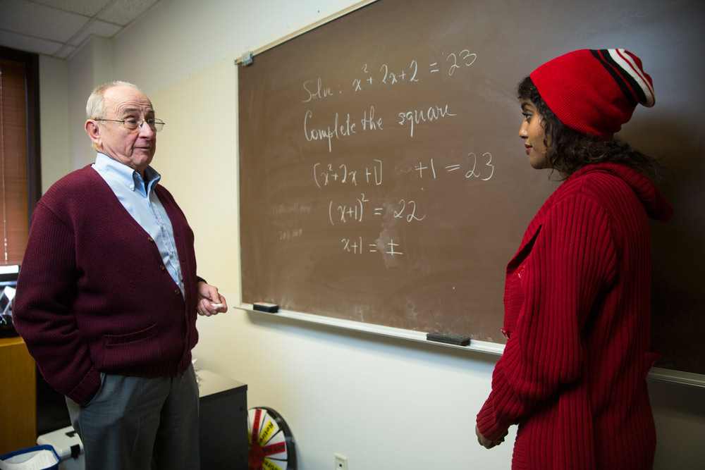 University of Utah math professor Hugo Rossi, left, who founded the ACCESS program in 1991, discusses an equation with student Joza Ibrahim.