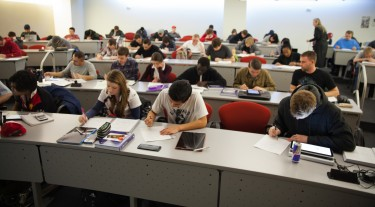 """Students in Cynthia Furse's """"flipped"""" engineering class at the University of Utah use class time to engage in interactive problem-solving. They watch short videotaped lectures before coming to class and review key concepts online."""