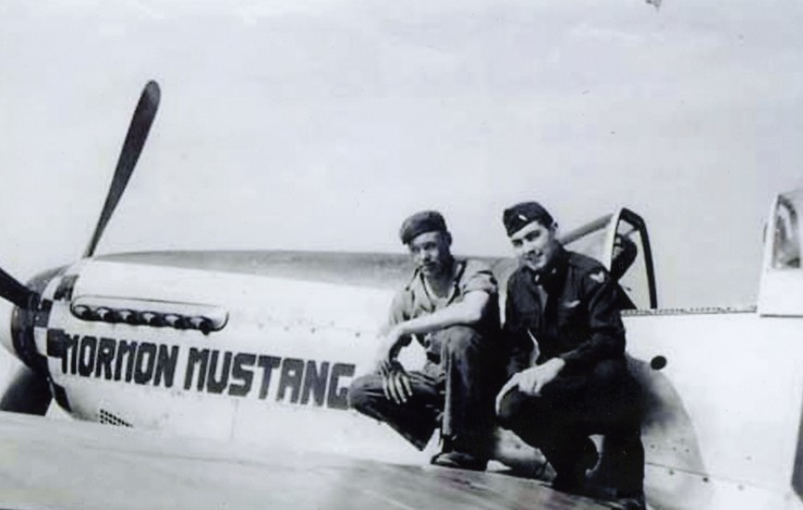 Roland R. Wright, shown at right, sits on the wing of his P-51 Mustang during World War II. Photo courtesy Roland R. Wright