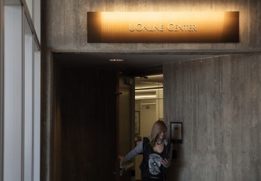 A student exits the UOnline office in the J. Willard Marriott Library. More than 19,500 students now take online courses.