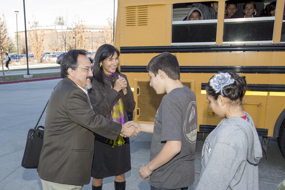 Octavio Villalpando, left, and Dolores Delgado Bernal greet Jackson Elementary School students visiting the University of Utah campus.