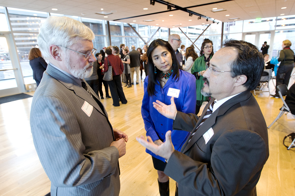 Octavio Villalpando, right, and Dolores Delgado Bernal talk with U President David W. Pershing at the Women's Week 2014 reception in March.