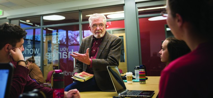 U professor emeritus Jack Newell teaches students in an Honors College course held at the Donna Garff Marriott Honors Residential Scholars Community.