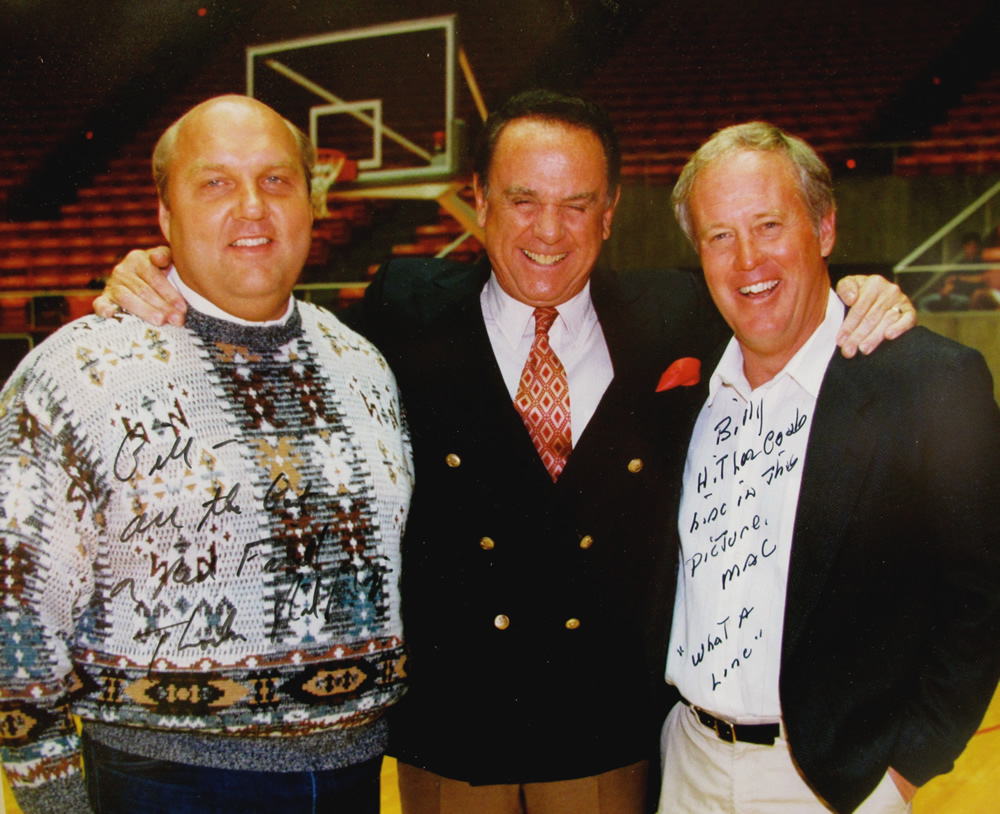 Bill Marcroft joins Rick Majerus, left, then head coach of the U men's basketball team, and Ron McBride, the head football coach, on the floor of the Huntsman Center in 2000 during a fan appreciation night.