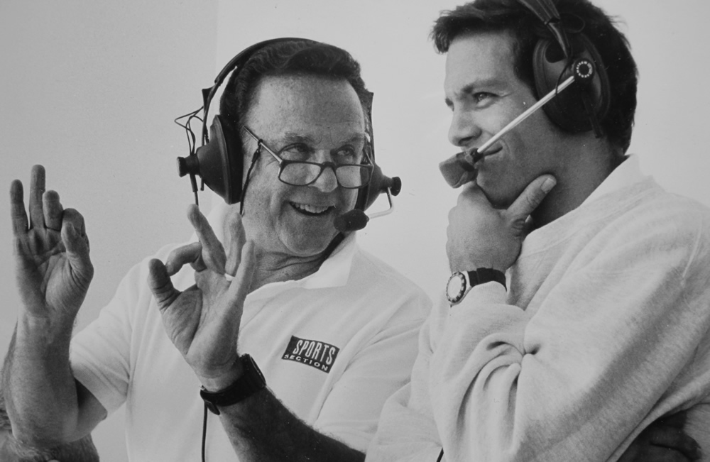 Bill Marcroft, left, works in his broadcasting booth at Rice-Eccles Stadium in the mid-1990s with Frank Dolce, a former University of Utah quarterback who provided color for Marcroft's Utah game coverage. (photo courtesy Bill Marcroft)