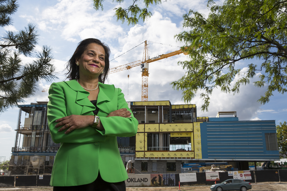 Rena D'Souza, dean of the U School of Dentistry, stands in front of the construction site of the Ray and Tye Noorda Oral Health Education Building, slated for completion in December.