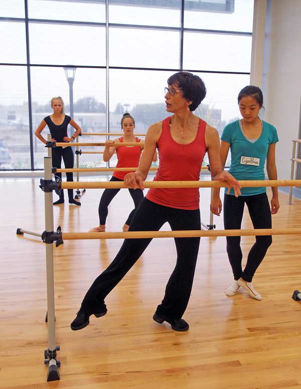 Dance professor Sharee Lane works with students, from left, Megan Kleinman, Anne Burton, and Cynthia Chen during a class at the U's Sorenson Complex. (Photo by Brian Nicholson)
