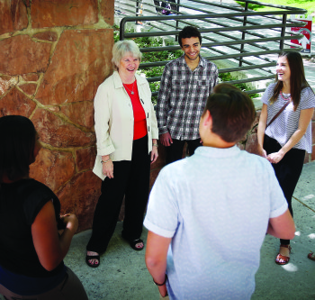 Barbara Snyder, the U's vice president of student affairs, with students outside the U's Union Building.