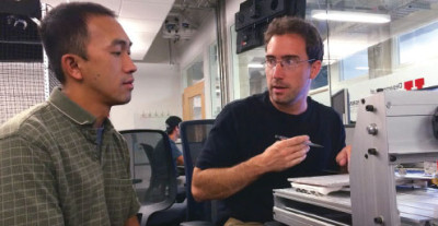 Leang with doctoral student Jim Carrico, whose research focuses on 3-D printing of electroactive polymers to create soft robots. (Photo by Dave Titensor).