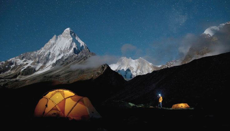 The climbers camp out under a starry sky in this still from the documentary Meru. Photos by Jimmy Chin, courtesy of Music Box Films