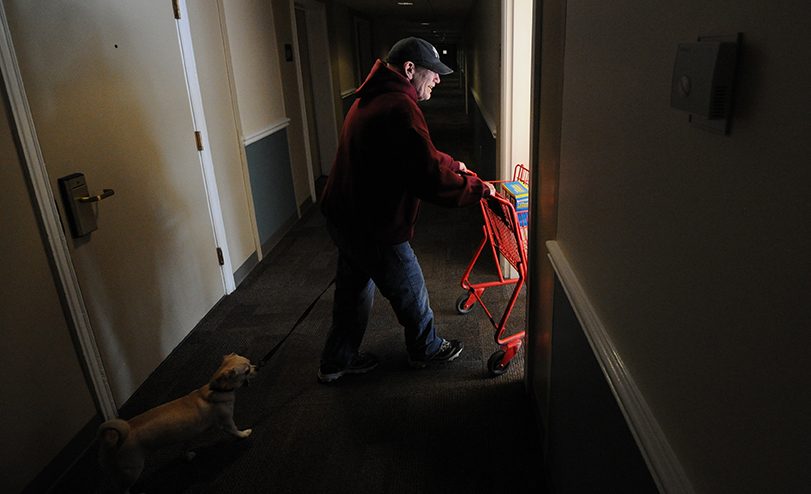 Palmer Court resident Richard Williamson and his dog Lucky take care of business on laundry day.