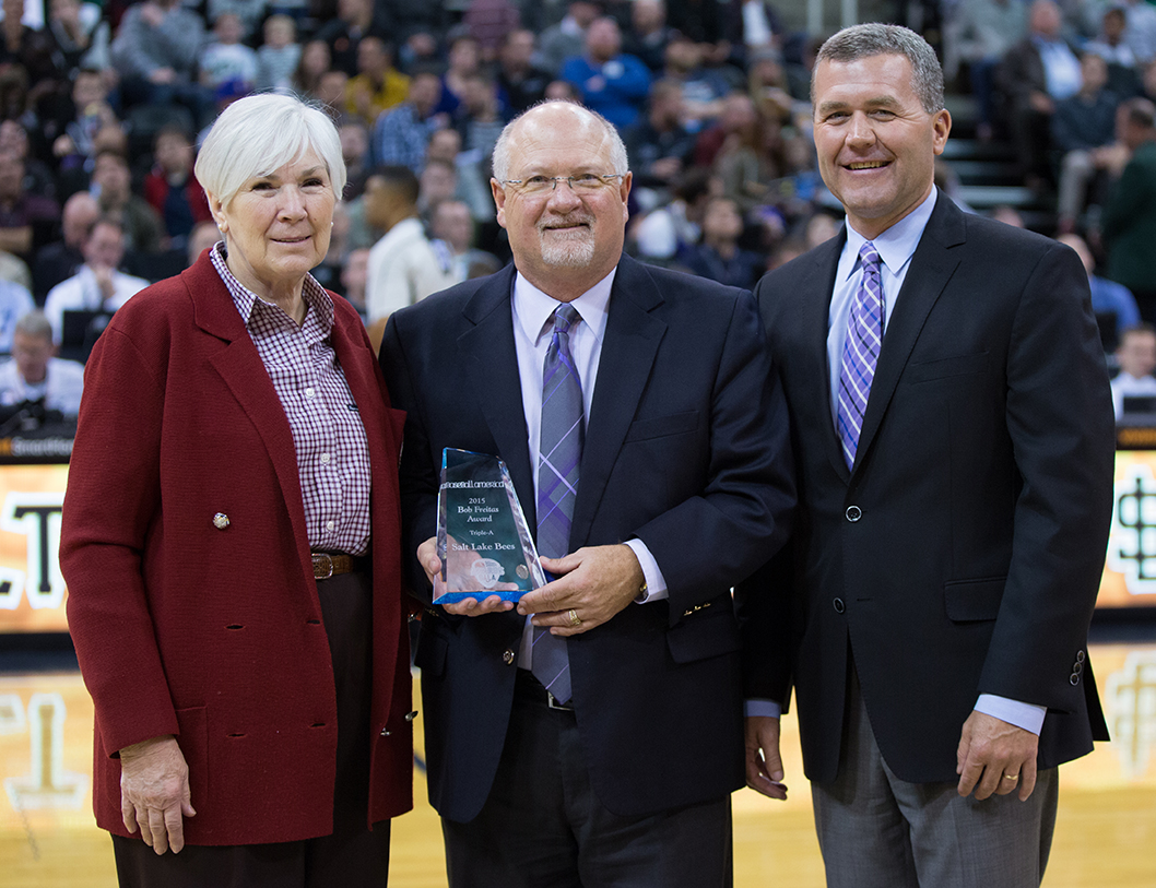 Marc Amicone (center) proudly displays the 2015 Bob Freitas Award with Gail Miller, owner of the Larry H. Miller Group of Companies, and Jim Olson BS'92 MS'93, COO of Miller Sports Properties. (Photo by Brent Asay/Salt Lake Bees)