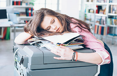 Young woman sleeping in office